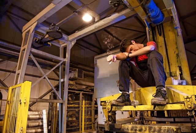 1_bigstock-Exhausted-factory-worker-smoki-13213847
